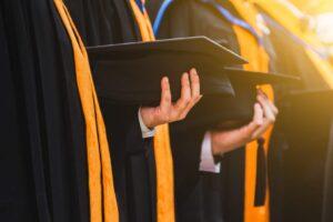 Students holding graduation hats